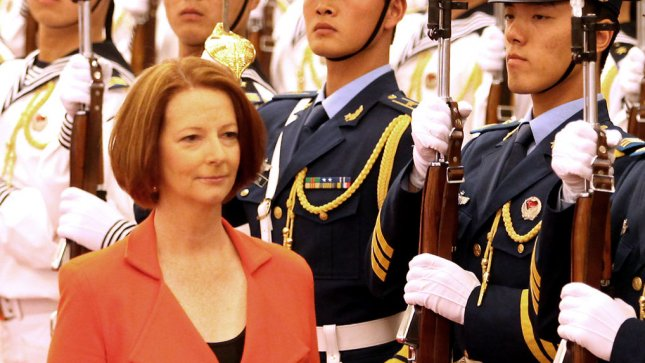 Australian Prime Minister Julia Gillard walks past a military honor guard during a welcoming ceremony in the Great Hall of the People in Beijing on April 26, 2011. China is Australia's biggest consumer of her nation's coal and iron ore deposits. UPI/Stephen Shaver