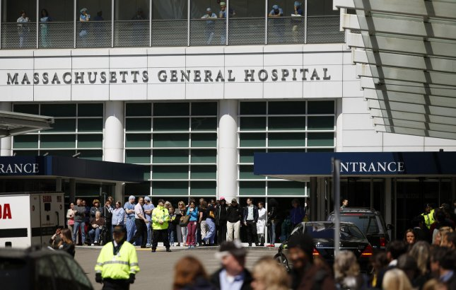 People swarm the entrance of Massachusetts General Hospital in Boston after President Barack Obama stopped by on April 18, 2013. UPI/Matthew Healey