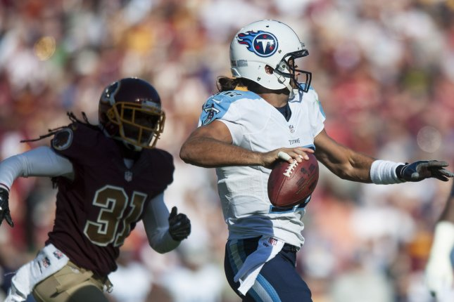 Former Tennesee Titans' quarterback Charlie Whitehurst under pressure from the Redskins' defense during the fourth quarter at FedEx Field in Landover, Maryland on October 19, 2014. Washington won the game 19-17 on a last second field goal by Kai Forbath. UPI/Pete Marovich