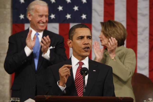 President Barack Obama acknowledges applause before his address to a joint session of Congress on February 24, 2009. Vice President Joe Biden and Speaker of the House Nancy Pelosi applaud behind him. File Pool Photo by Pablo Martinez Monsivais/UPI