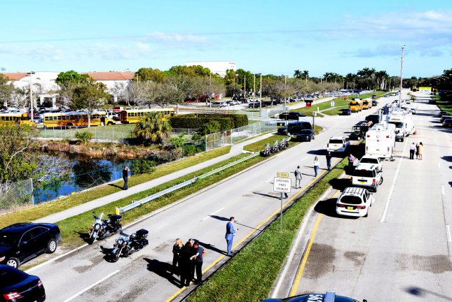 A large police presence remains outside of Marjory Stoneman Douglas High School on February 15, 2018 in Parkland, Florida. A former student is in custody after 17 students and teachers were shot and killed February 14. Photo by Gary Rothstein/UPI