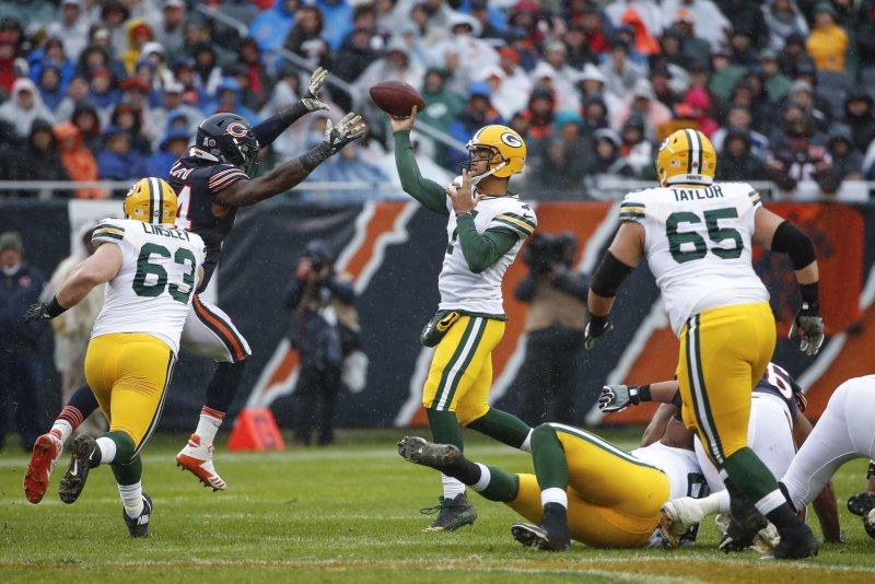 09d63148475 Green Bay Packers backup quarterback Brett Hundley (7) passes the ball  against Chicago Bears outside linebacker Leonard Floyd (94) during the  first half on ...