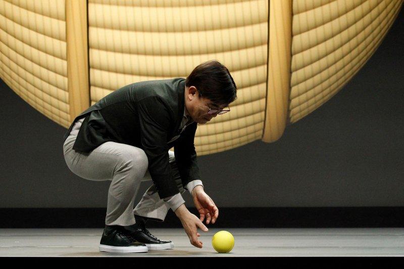 Samsung CEO Kim Hyun-suk demonstrates the Ballie robot during his keynote presentation at the 2020 International CES in Las Vegas on Monday. Photo by James Atoa/UPI