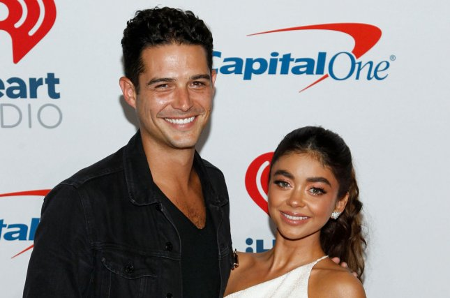 Wells Adams and Sarah Hyland shared photos of themselves dressed as Tiger King stars Carole Baskin and Joe Exotic. File Photo by James Atoa/UPI