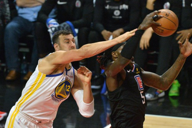 Former Golden State Warriors center Andrew Bogut (12) won an NBA championship with the Warriors in 2015. File Photo by Jim Ruymen/UPI
