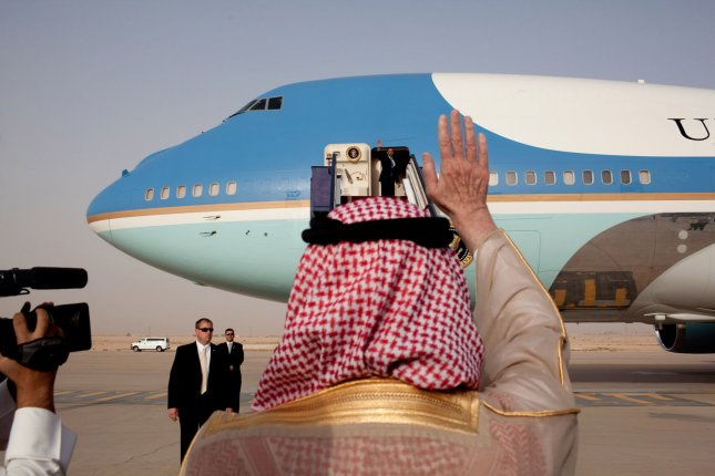 President Barack Obama waves goodbye from the steps of Air Force One as he departs King Khalid International Airport in Riyadh, Saudi Arabia on his way to Cairo, Egypt, June 4, 2009. (UPI Photo/Pete Souza/White House)
