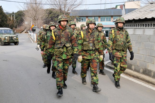 South Korean marines walk on Yeonpyeong island, South Korea. North Korea issued an advisory against frontline inspections on Friday, a statement that was quickly condemned in Seoul. File Photo by Keizo Mori/UPI