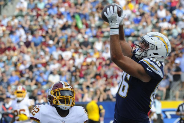 Los Angeles Chargers tight end Hunter Henry (R) is expected to miss four to six weeks due to a tibial plateau fracture to his left knee. File Photo by Lori Shepler/UPI
