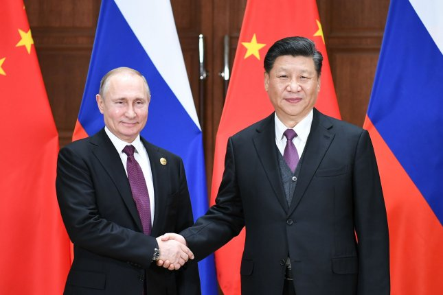 Russian President Vladimir Putin (L) and Chinese President Xi Jinping are increasingly coordinated on foreign policy, including North Korea. File Pool Photo by Xie Huanchi/UPI