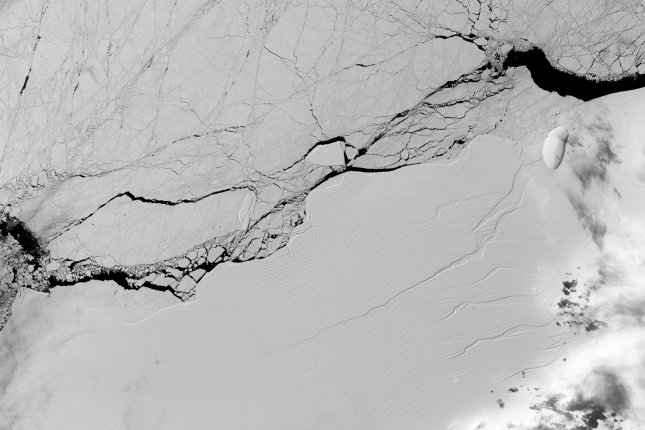 A long crack is seen across the Larsen C Ice Shelf, as seen by the Operational Land Imager on the NASA/USGS Landsat 8 spacecraft in 2017, is one of the largest remaining shelves in Antarctica -- but researchers are worried about the threat that warmer temperatures pose to its health. File Photo by NASA/UPI