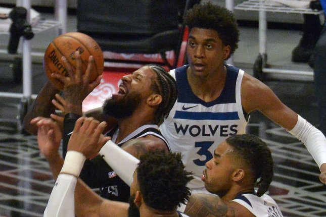 Los Angeles Clippers guard Paul George (L) is fouled by Minnesota Timberwolves guard D'Angelo Russell (R) during a game Sunday at Staples Center in Los Angeles. Photo by Jim Ruymen/UPI