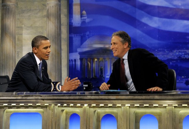 U.S. President Barack Obama chats with Daily Show host Jon Stewart during a commercial break in taping in Washington on October 27, 2010. UPI/Roger L. Wollenberg