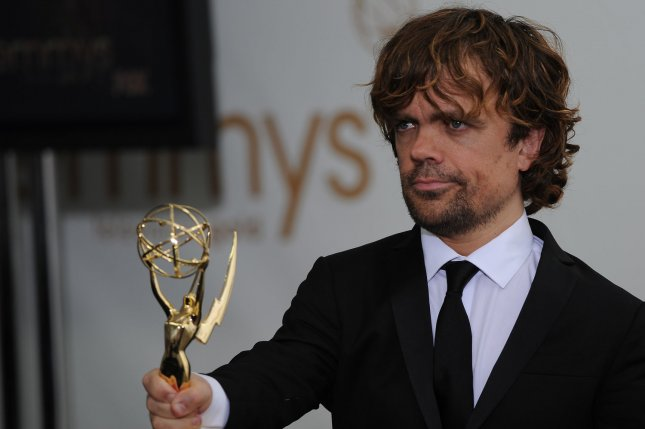 Peter Dinklage holds his award for Best Supporting Actor in a Drama Series for Game of Thrones at the 63rd Primetime Emmy Awards at the Nokia Theatre in Los Angeles on September 18, 2011. UPI/Jayne Kamin Oncea