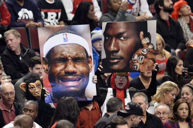 0919bca4cef Fans hold up photos of Cleveland Cavaliers forward LeBron James (L) and  Chicago Bulls legend Michael Jordan at the United Center in Chicago