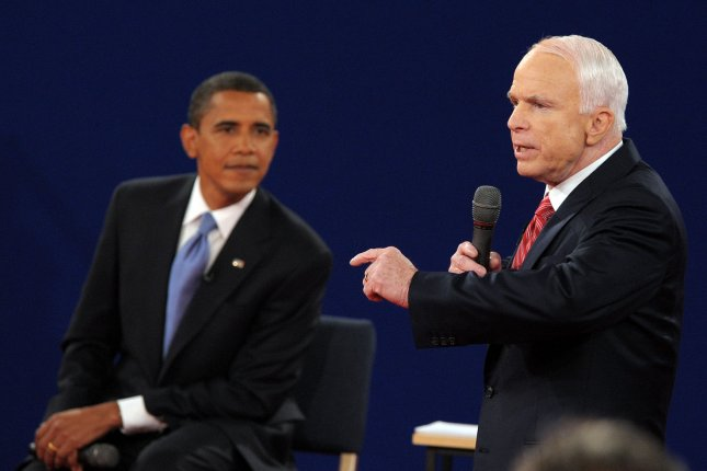 Senators Barack Obama and John McCain participate in a U.S. presidential debate at Belmont University in Nashville, Tenn., on October 7, 2008. McCain asked his onetime political rival to deliver a eulogy at his funeral. File Photo by Roger L. Wollenberg/UPI
