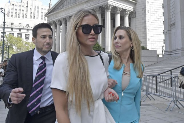 Alleged victim of billionaire Jeffrey Epstein Jennifer Araoz (C) exits Manhattan Federal Court on Tuesday. Photo by Louis Lanzano/UPI