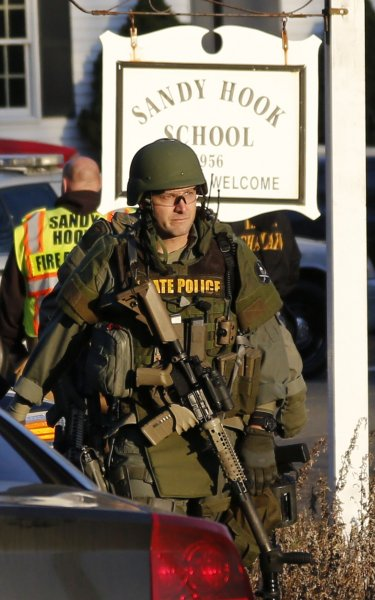 Police respond to Sandy Hook Elementary School in Newtown, Conn., on December 14, 2012, after a shooting attack killed 20 kindergarten and first-grade children. File Photo by John Angelillo/UPI