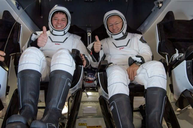 NASA astronauts Bob Behnken (L) and Doug Hurley are seen inside the SpaceX Crew Dragon Endeavour spacecraft after landing in the Gulf of Mexico on Aug. 2. Photo courtesy of NASA