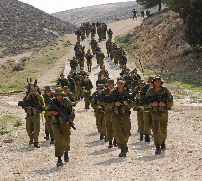 Israeli soldiers from the Givati Brigade walk the sixty kilometer beret march from Beit Haya'aran to Masada, March 25, 2009. The Givati Brigade, a combat unit in the Israeli Defense Force, played a significant role in operation Cast Lead in Gaza.(UPI Photo/Debbie Hill)
