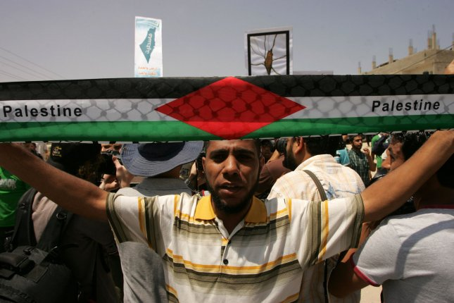 Palestinian protesters shout slogans during a protest near the Erez border crossing between the northern Gaza and Israel June 5, 2011, marking the 44th anniversary of the start of a 1967 Middle East War in which Israel captured East Jerusalem, the Gaza Strip, the West Bank and Golan Heights. UPI/Ismael Mohamad.
