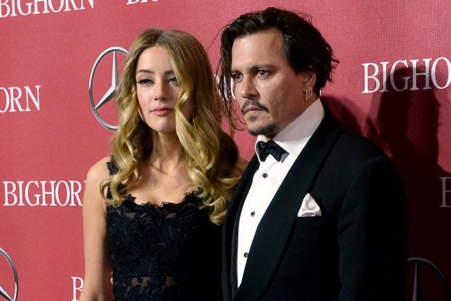 Actors Amber Heard and Johnny Depp attend the 27th annual Palm Springs International Film Festival awards gala on January 2, 2016. Photo by Jim Ruymen/UPI