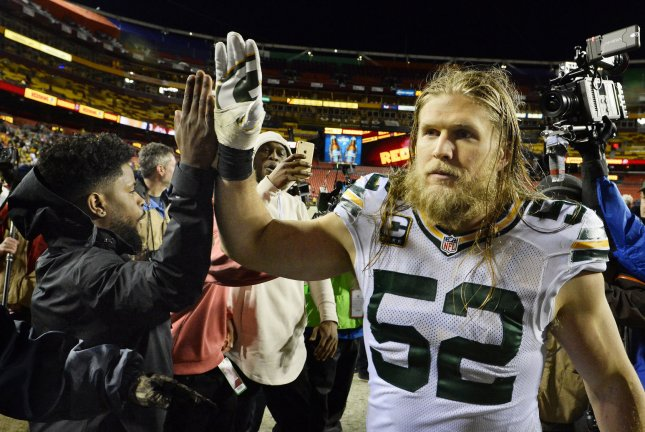 Green Bay Packers inside linebacker Clay Matthews (52) gets a high-five after defeating the Washington Redskins 35-18 in their NFC Wild Card game at FedEx Field in Landover, Maryland, January 10, 2016. Photo by David Tulis/UPI