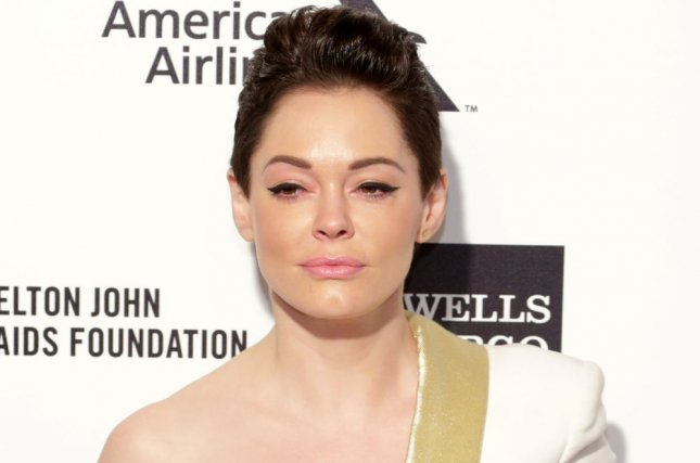 Rose McGowan is seen shaving her head in the cover to her memoir, Brave. File Photo by Jonathan Alcorn/UPI