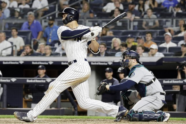 New York Yankees hitter Giancarlo Stanton hits a walk-off two-run home run in the ninth inning against the Seattle Mariners on June 20, 2018 at Yankee Stadium in New York City. Photo by John Angelillo/UPI