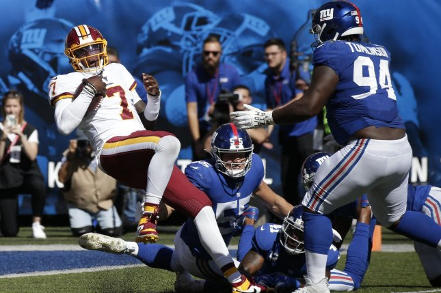Washington Redskins rookie quarterback Dwayne Haskins (7) completed 12-of-15 passes for 133 yards and two touchdowns before exiting in the third quarter. File Photo by John Angelillo/UPI