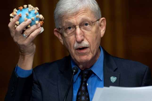 Dr. Francis Collins, director of the National Institutes of Health, holds a model of COVID-19 during testimony Thursday at a Senate appropriations subcommittee hearing on plans to research, manufacture and distribute a coronavirus vaccine. Photo by Saul Loeb/UPI/Pool