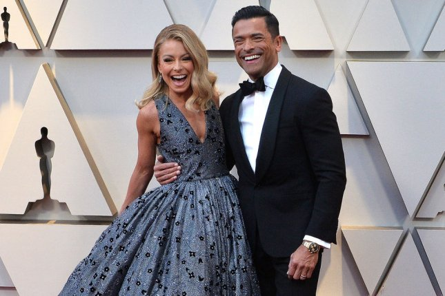 Kelly Ripa (L) and Mark Consuelos arrive on the red carpet for the Academy Awards in 2019. The married couple are executive producing a primetime version of All My Children. File Photo by Jim Ruymen/UPI