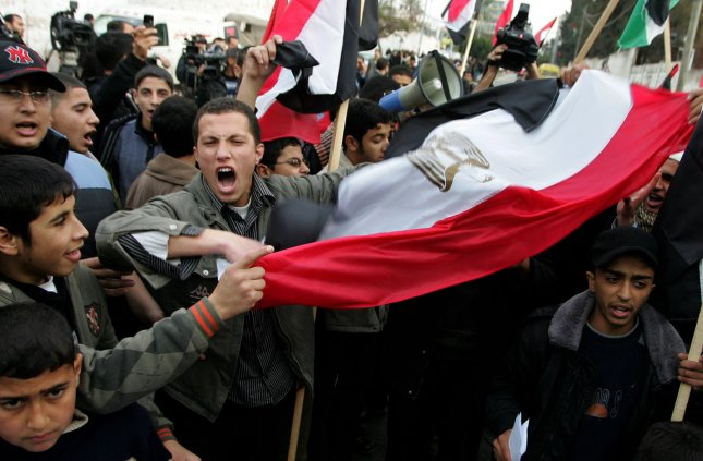 Palestinian protesters wave Egyptian flags and shout slogans during a demonstration outside the offices of the Egyptian diplomatic mission in support of the anti-government protests in Egypt calling for an end to President Hosni Mubarak's 30-year rule, in Gaza City on February 3, 2011. UPI/Ismael Mohamad