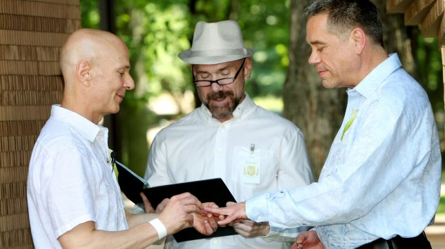 Clay Schudel (L) and Ken Lindley exchange vows as they wed inside a pop-up chapel set up in Central Park on July 30, 2011 in New York City. UPI /Monika Graff