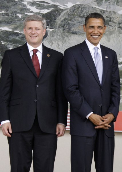 Canadian Prime Minister Stephen Harper (L) and U.S. President Barack Obama pose during the G8 leaders group photo at the G8 summit in L'Aquila, Italy on July 8, 2009. (UPI Photo/Anatoli Zhdanov)