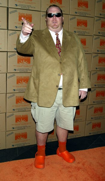 Mario Batali arrives for the Food Bank For New York City's Can-Do Awards Gala at Pier Sixty, Chelsea Piers in New York on April 25, 2006. (UPI Photo/Laura Cavanaugh)