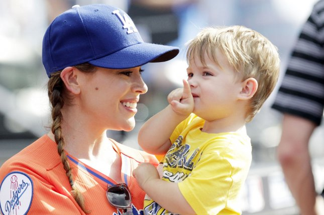 Alyssa Milano and baby Milo Thomas stand on the field at the All-Star Legends & Celebrity Softball Game at Citi Field in New York City on July 14, 2013. The New York Mets will host their first Major League Baseball All-Star Game since 1964. UPI/John Angelillo