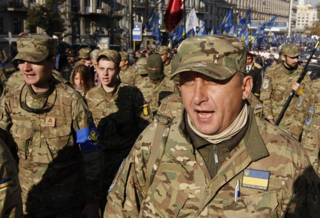 Pro-government volunteers march in Kiev, Ukraine. A United Nations report Thursday was critical of the limited accountability for numerous deaths on both sides of the conflict. Photo by van Vakolenko/UPI