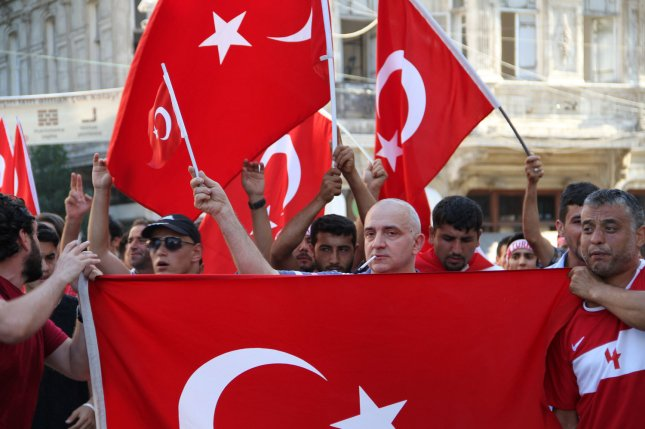 People wave Turkish flags during a demonstration in support of the Turkish president in Istanbul, Turkey on Saturday. President Recep Tayyip Erdogan battled to regain control over Turkey after a coup that claimed more than 250 lives, led by discontented soldiers In the army. Photo by Hanna Noori/ UPI