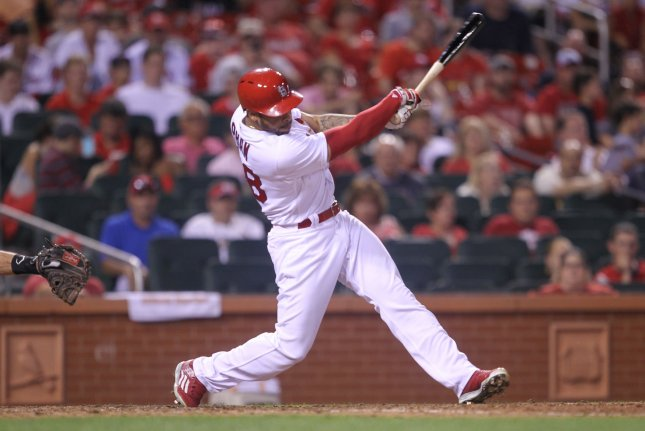 St. Louis Cardinals' Tommy Pham swings and gets a hit. File photo by Bill Greenblatt/UPI