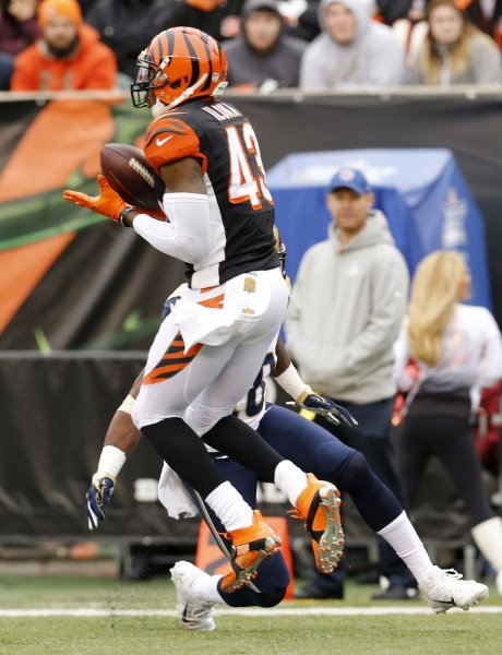 Cincinnati Bengals safety George Iloka intercepts a pass during a game against the Los Angeles Rams. Photo by John Sommers II/UPI