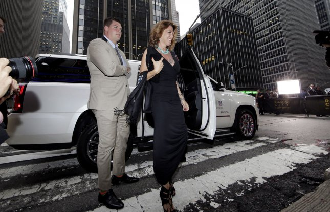 Taylor Lewan and his mom arrive at the 2014 NFL draft. Lewan, a member of the Tennessee Titans, is now the NFL's highest-paid lineman. File photo by John Angelillo/UPI