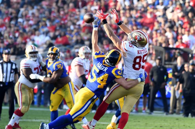 Los Angeles Rams defender Bryce Hager (L) breaks up a pass intended for San Francisco 49ers tight end George Kittle (85) on December 31, 2017 in Los Angeles. Photo by Jon SooHoo/UPI