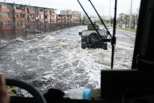 Members of the Puerto Rico National Guard patrol one of the flooded main highways in San Juan, Puerto Rico, on Sep. 22, 2017. Photo by Sgt. Jose Diaz-Ramos/Puerto Rico National Guard/UPI