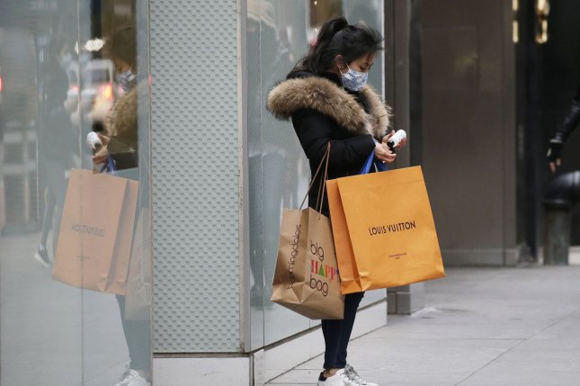 A shopper emerges from a retail store on New York City's Fifth Avenue on January 5. File Photo by John Angelillo/UPI