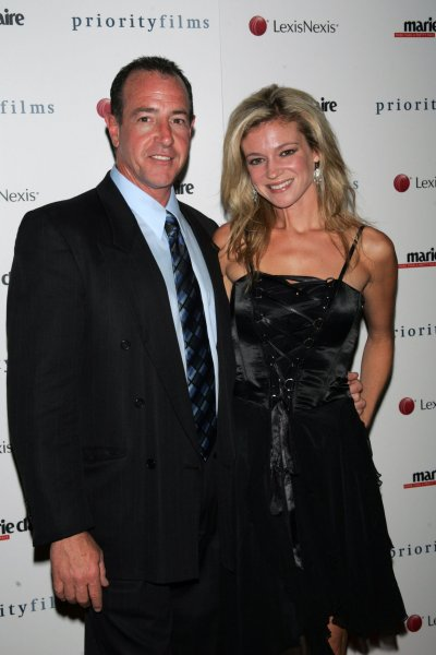 Michael Lohan and date arrive for the screening of Holly at the Joseph Urban Theater in the Hearst Tower in New York on August 5, 2008. (UPI Photo/Laura Cavanaugh)
