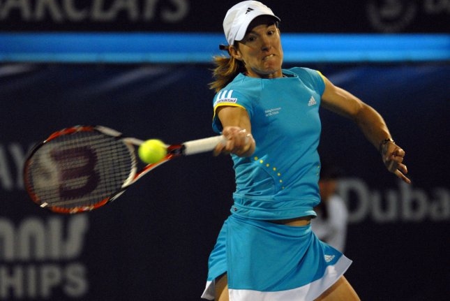 World number one, Justine Henin, from Belgium returns the ball from her opponent, Francesca Schiavone, from Italy, during the quarter finals of the Dubai Tennis Championships on Thursday February 28, 2008. Schiavone won the match 7-6 7-6. (UPI Photo/Norbert Schiller)