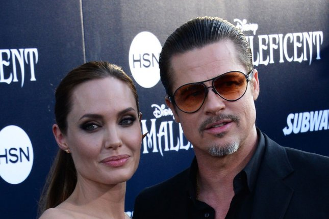 Angelina Jolie and Brad Pitt attend the premiere of Maleficent in Los Angeles on May 28, 2014. Photo by Jim Ruymen/UPI