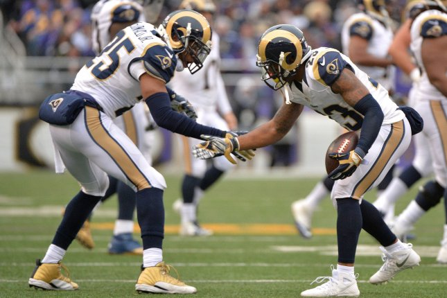 St. Louis Rams' Rodney McLeod (R) celebrates with teammate T.J. McDonald after intercepting a pass thrown by Baltimore Ravens quarterback Joe Flacco in the second quarter at M&T Bank Stadium in Baltimore, Maryland on November 22, 2015. Photo by Kevin Dietsch/UPI