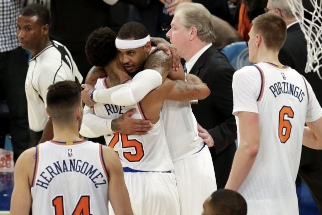 d75c29d69c4 New York Knicks  Carmelo Anthony hugs Derrick Rose after Rose after the  game against the Charlotte Hornets at Madison Square Garden in New York  City on ...