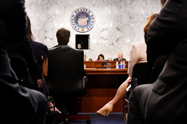 Ashley Estes Kavanaugh (R) and her husband, Supreme Court Justice nominee Brett M. Kavanaugh, listen before the Senate Judiciary Committee on Tuesday for the first day of his confirmation hearings. Photo by Pat Benic/UPI